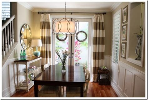 striped curtains ans taupe walls dining room