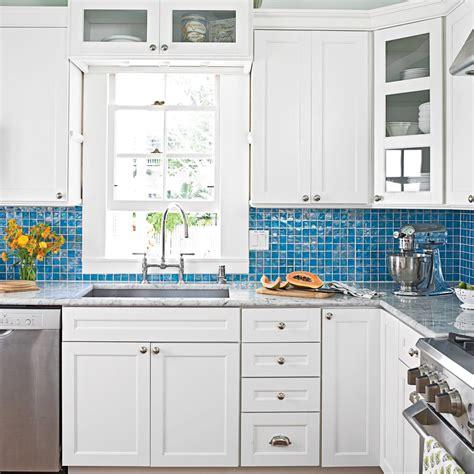 white kitchen  blue glass backsplash  breezy island