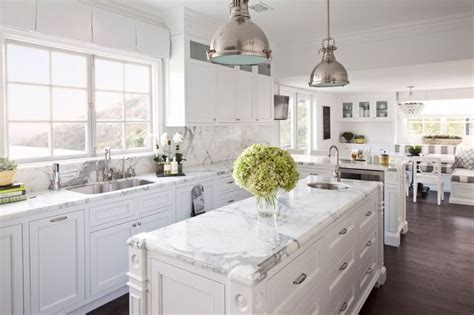 Hamptons style white kitchen with shaker cabinets, marble