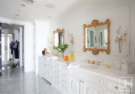 White And Gold Bathroom With Gold Orante Mirrors