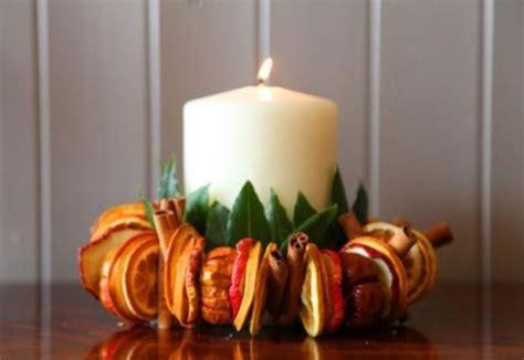 decorare le candele decorazioni di natale con arance e spezie foto ultime