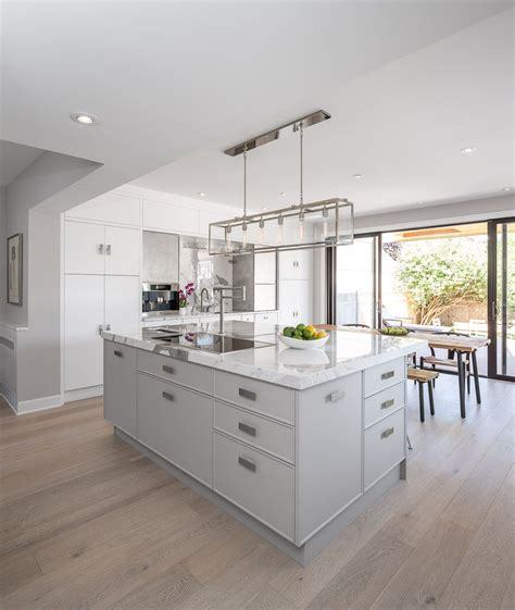 Kitchen Designed Comfort featuring our visual comfort co light fixture a white