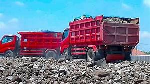 Isuzu Mitsubishi Dump truck Unloading gravel from their ...