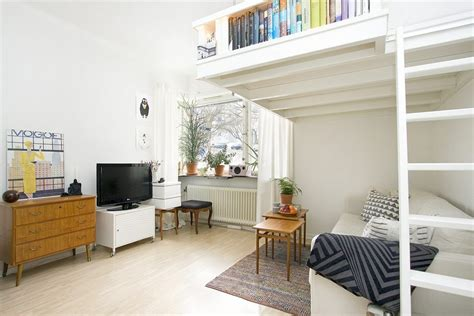 Small Swedish Studio Apartment Elegantly Combines Loft Bed