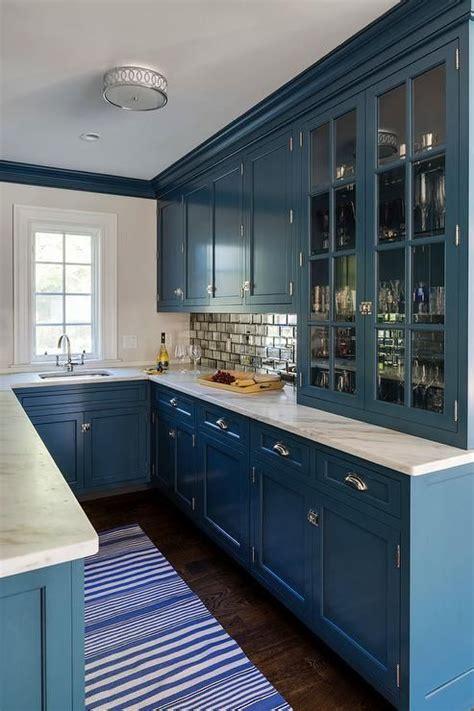 stunning blue  shped wet bar  lit   nickel flush