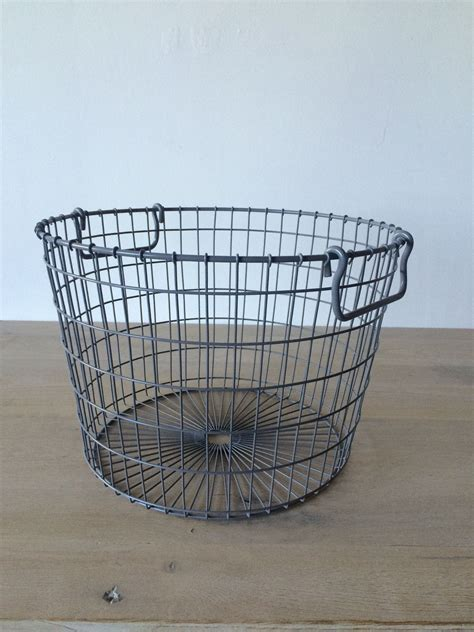 that these new baskets inspired by vintage potato baskets come in bright modern colors
