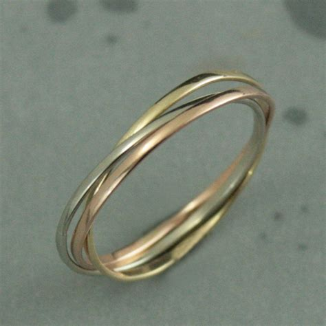 now our popular rolling rings are available in solid 10k gold each band in this