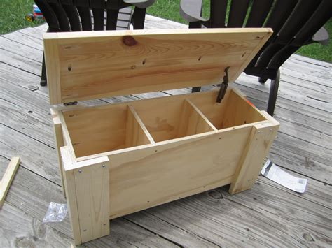 diy outdoor wood storage box with lid and leg as bench