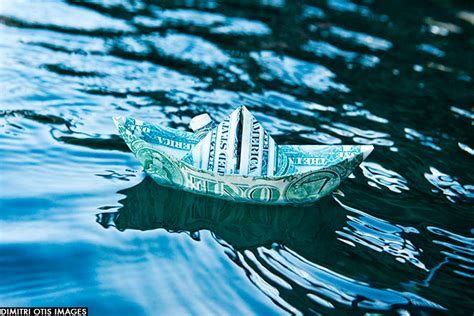 Origami Boat In Water by Dimitri Otis Images Business