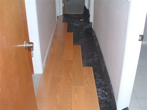 how to lay out a room for laminate flooring installing laminate down hallways from another room