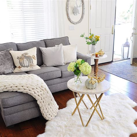 Adding Interest To Neutral Decor by Neutral Living Room Decor For Fall 2 A Chair