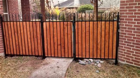 wrought iron wood fence really cool wrought iron and cedar privacy fence from houston quality fenicng http www