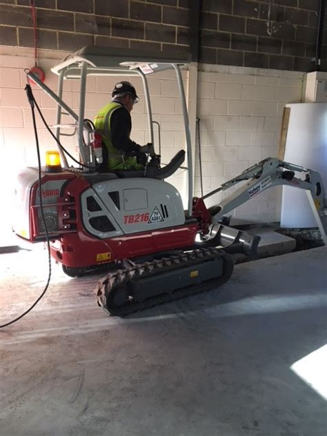 takeuchi tbh hybrid electric mini digger plant hire guide