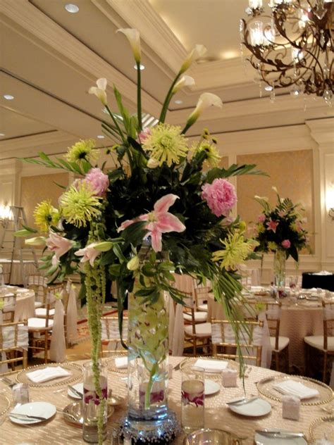 tall flower arrangements  weddings wedding reception
