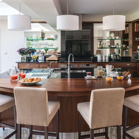 Walnut kitchen with curved breakfast bar   Kitchen