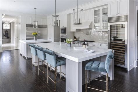 gray kitchen island  blue velvet tufted counter stools