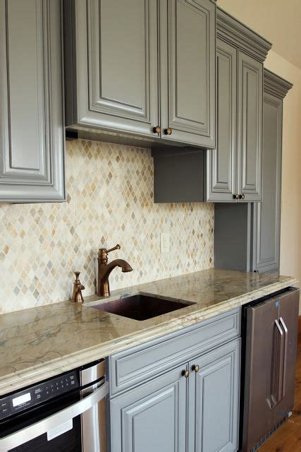"""A Neutral Mosaic Backsplash In The """"kitchen"""" Area Of A"""
