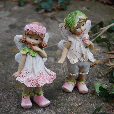 set of two standing flower resin garden ornaments