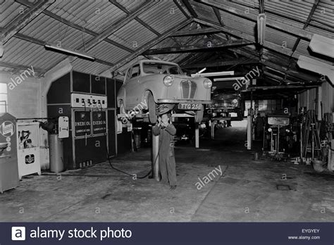 garage cardiff cardiff 1960 garage interior with mechanic stock photo