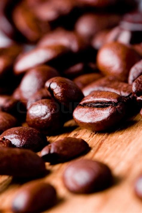 For those seeking a great coffee experience we created our diy coffee guides o. Fried coffee beans closeup on wooden ...   Stock Photo   Colourbox