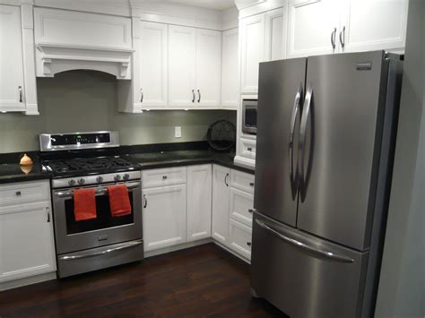White Cupboards With Stainless Steel Appliances by White Cabinets Black Granite Hardwood Stainless
