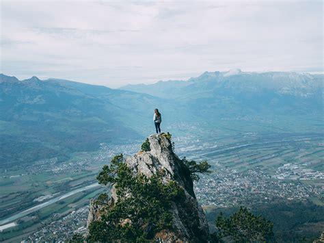 wallpaper girl standing   mountain top  uhd