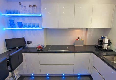 white gloss handless kitchen  acrylic finish