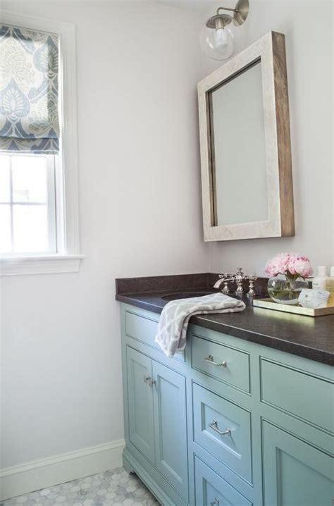 turquoise blue vanity with honed black granite countertop