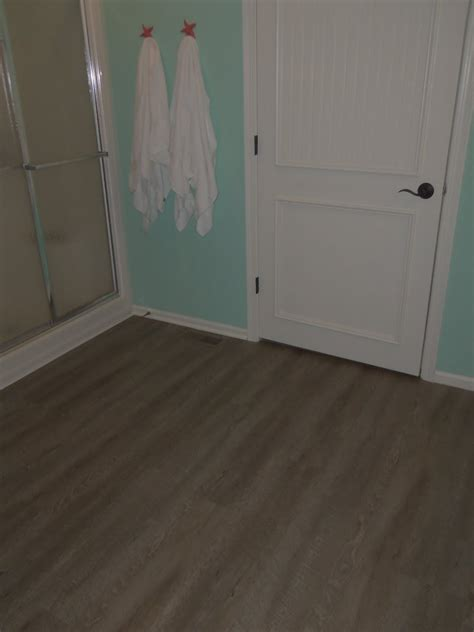 flooring plus flooring cool allure vinyl plank flooring plus turquoise wall and white doors for interior