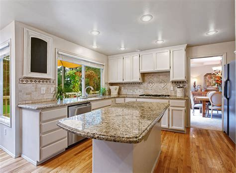 White Cabinets With Granite by Santa Cecilia Granite Countertops Design Cost Pros And