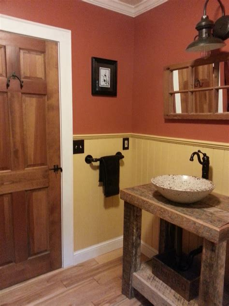 Primitive Bathroom Design Ideas by Barn Wall Sconce Adds A Touch Of Country To Bathroom