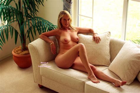 Nude Sexy Realtor Sitting On Couch With Bare Feet October Voyeur Web Hall Of Fame