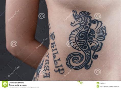 seahorse  ribs tattoo stock photo image