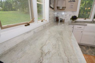 sea pearl quartzite  white cabinets  matching