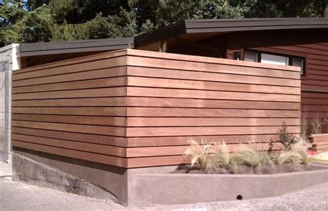 modern wooden fence  cement base adds clean lines