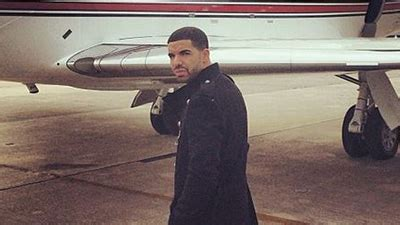 rapper drake poses  airplane  red sox logos calls