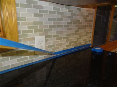 caulking kitchen backsplash one project at a time diy how to caulk kitchen