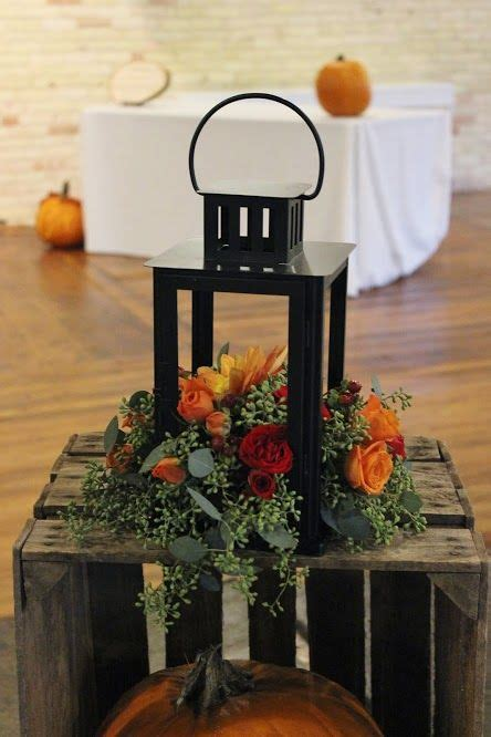 Flowers inside of a lantern to decorate a wedding at The