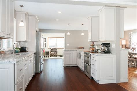 moon white granite with dark cabinets open floor plan in sharkey grey and moon white granite