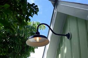 Gooseneck barn lights bring historic touch to conch style