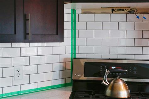 subway tile kitchen backsplash diy how we installed our subway tile backsplash stager 8403