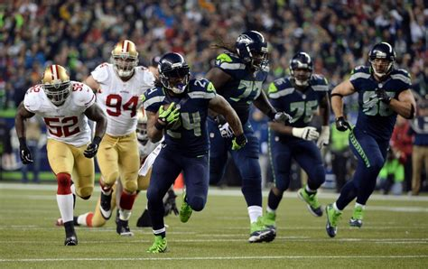 nfc championship seahawks hold  ers advance
