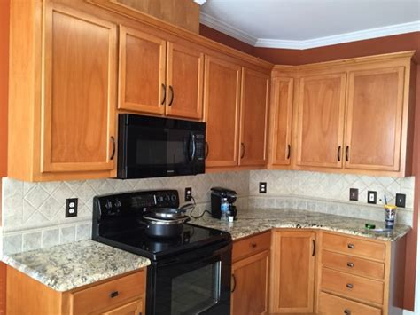 you stain or paint your kitchen cabinets for a should you replace your kitchen cabinets or paint them Should