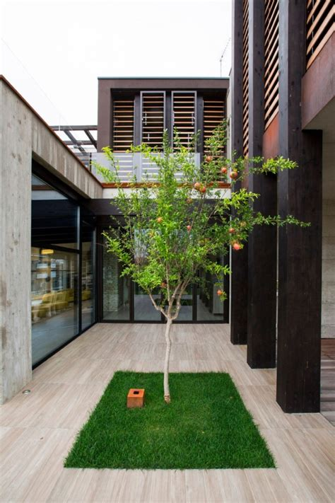 House Patio by Modern Concrete Block House With Wooden Patio Attached