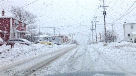 Flights Delayed Roads Slippery As Snow Falls In