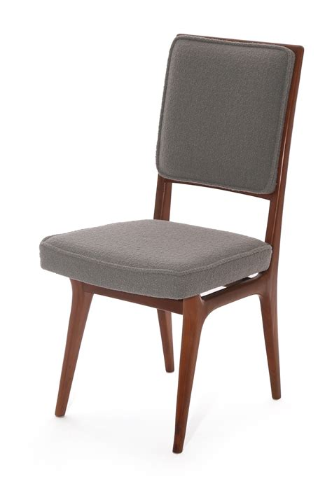 six sculpted walnut and upholstered dining chairs for sale
