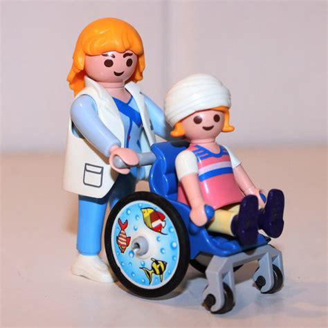 infirmi 232 re et enfant en fauteuil roulant play original