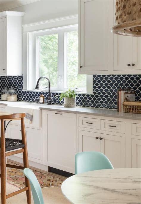black backsplash tiles  gray quartz counters