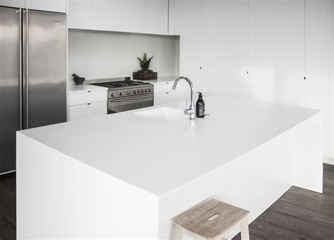 island in the kitchen glacier white corian solid surface enhances family kitchen