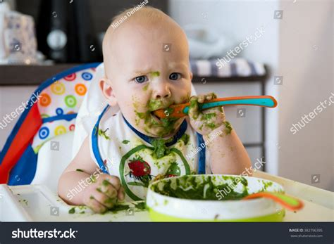 Feeding Adorable Baby Child Eating Spoon Stock Photo